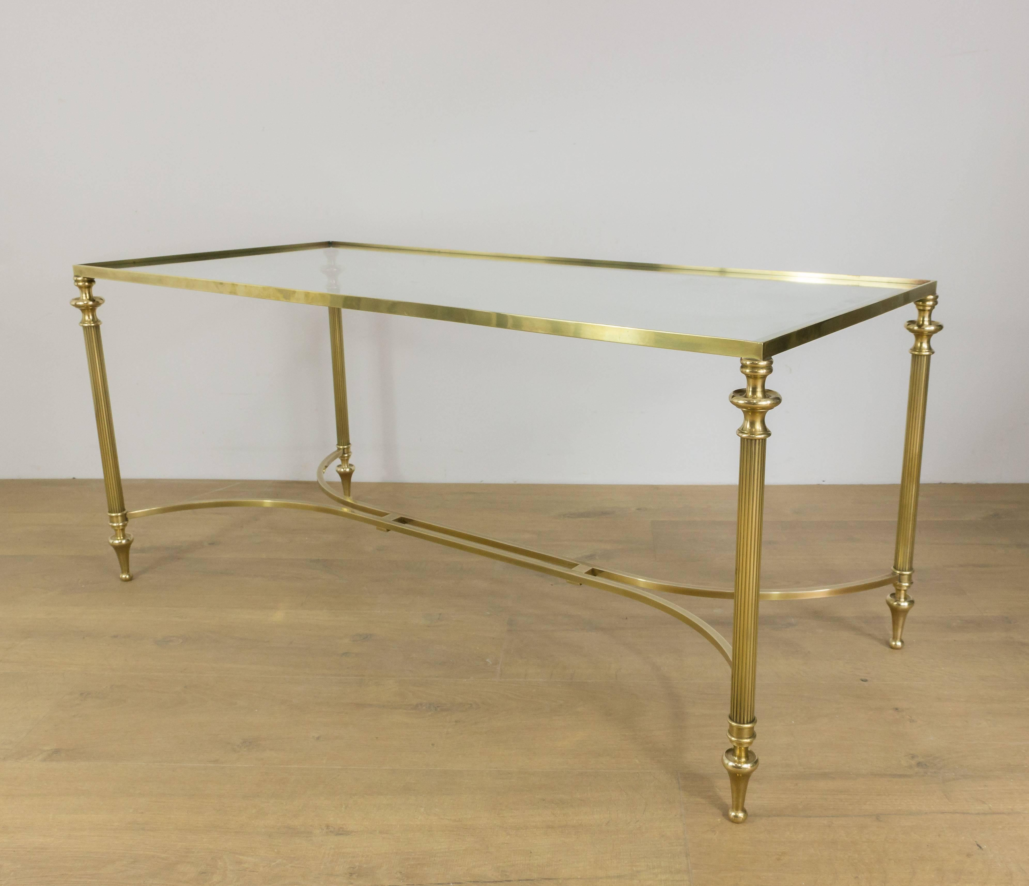 Neoclassical Brass Coffee Table With A Double Stretcher And Clear Glass Top.  French, Circa
