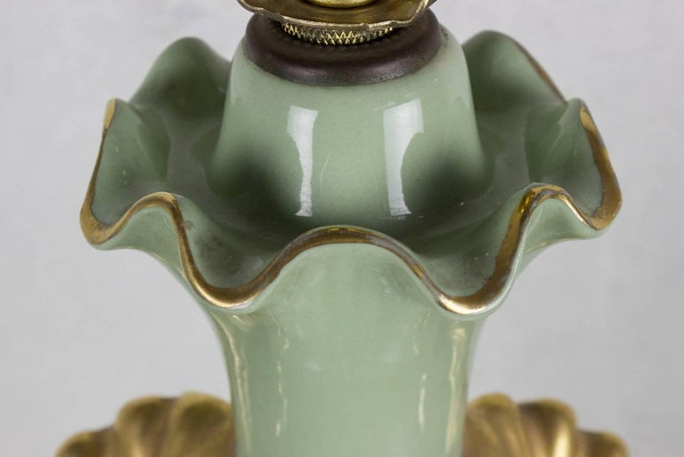 Celadon green porcelain table lamp with Art Nouveau motif. Not sold with shade.