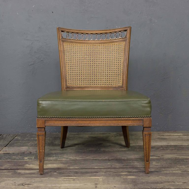 Pair of 1950s Italian side chairs in green leather with wicker back and brass detailing. These chairs are sold in