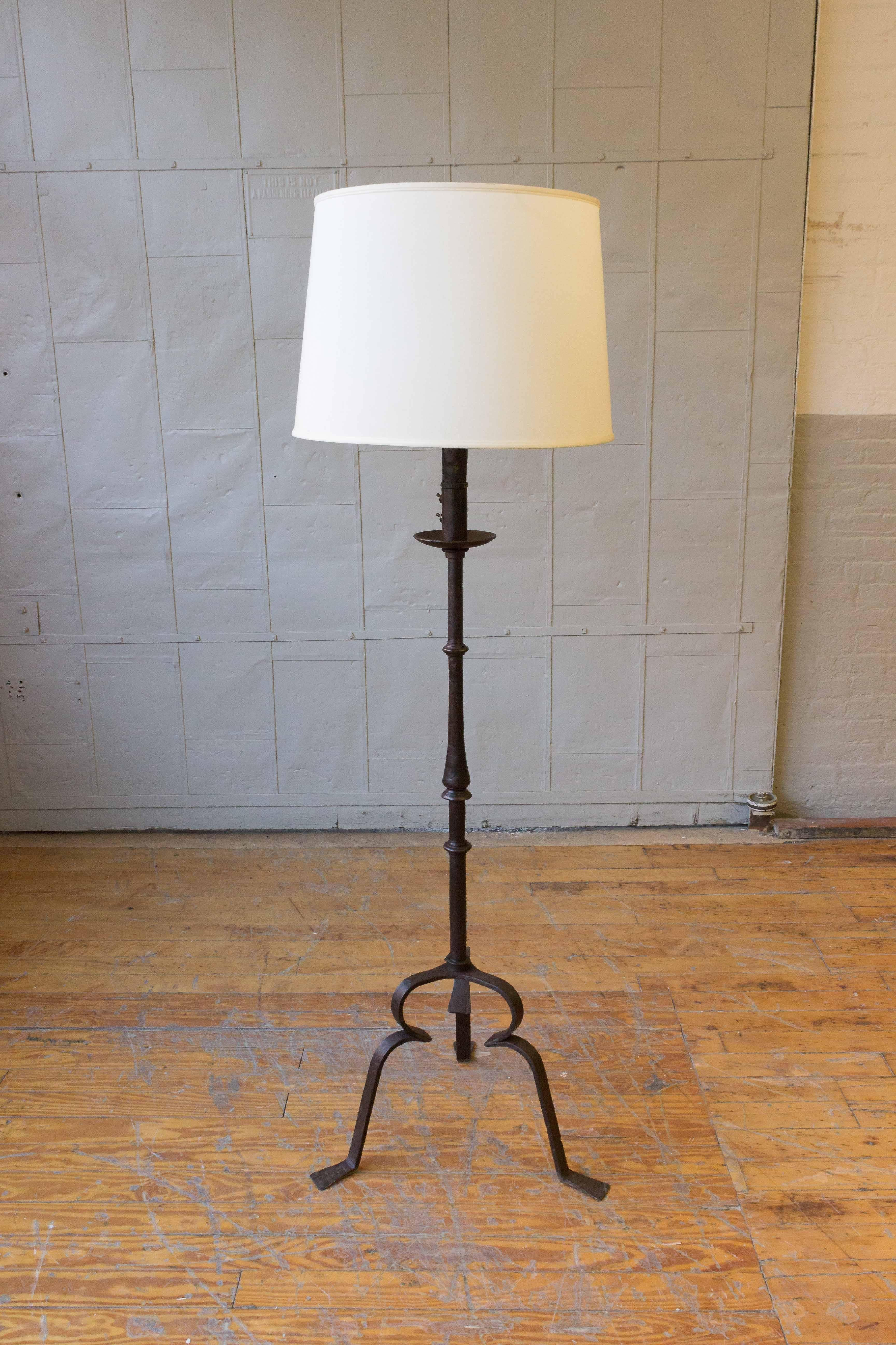 A Substantial And Heavy Wrought Iron Floor Lamp Having An Elegant Tripod  Base. The Iron