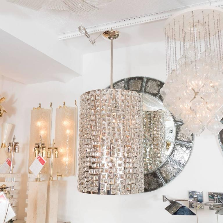 Large cylindrical, drum-form chrome pendant featuring applied facet cut crystal tile elements.