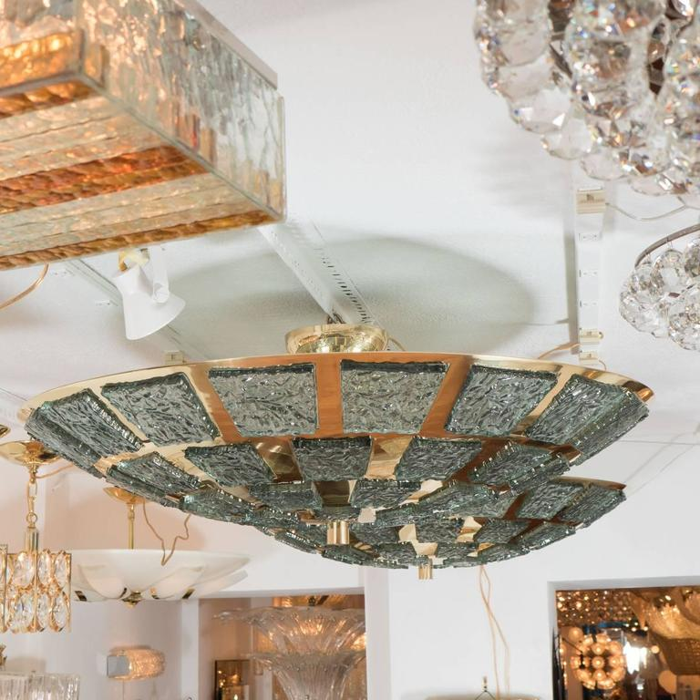 """Dome-form polished brass ceiling fixture featuring inset carved """"icy"""" Murano glass fragments."""