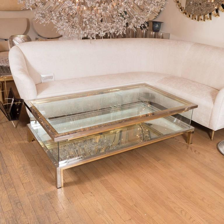 Rectangular brass, nickel and glass coffee table with sliding glass top by Willy Rizzo.