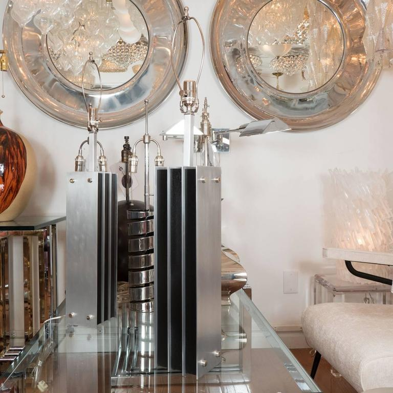 Pair of brushed nickel table and ebonized wood table lamps.