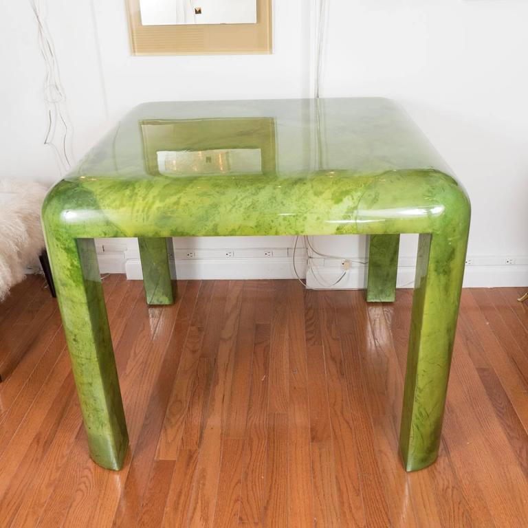Green, lacquered goatskin card table by Enrique Garcel. Signed.