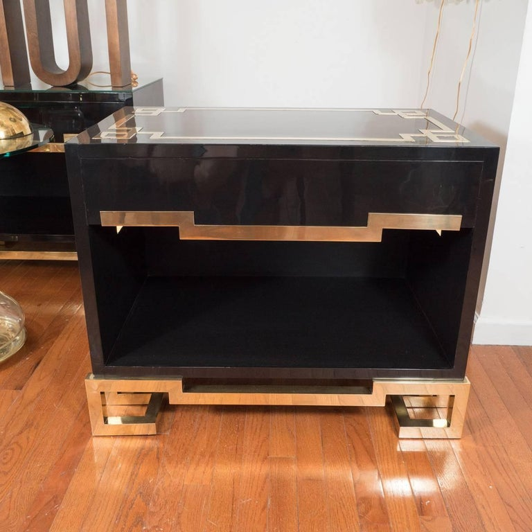Pair of Asian motif, lacquered wood and brass end tables with sub-shelf.