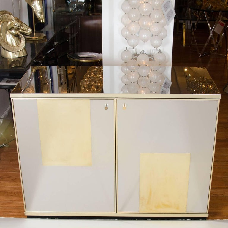 Polished stainless steel and brass chest featuring interior shelving by Sandro Petti.