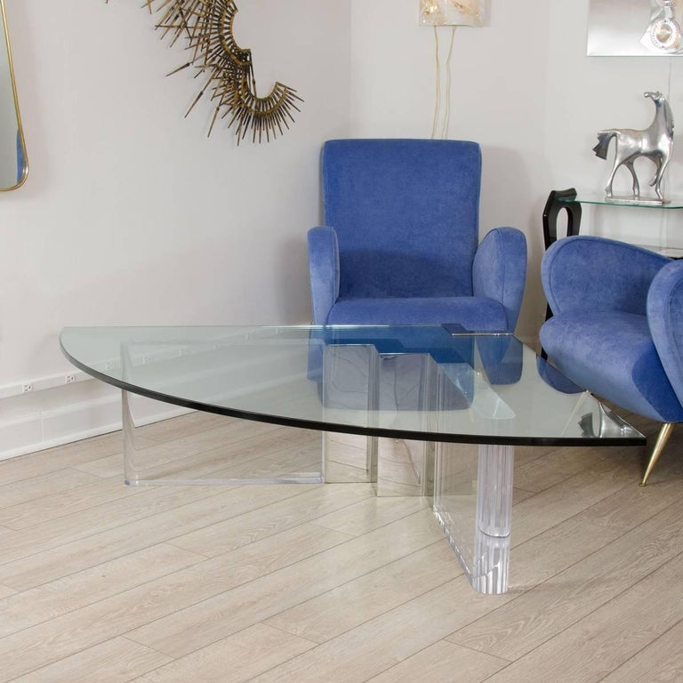 Wedge form Lucite and glass coffee table with chrome details