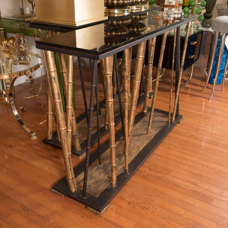 Gilt iron faux bamboo console table with reverse painted top.