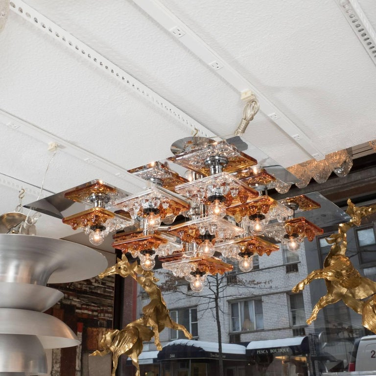 Tiered polished nickel chandelier with clear and amber Murano glass tile details by Mazzega.