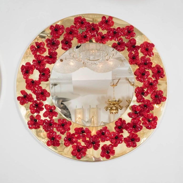Circular, brass frame mirror with red Murano glass flower surround.