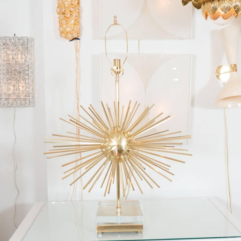 Pair of brass Sputnik style table lamps with glass block bases.