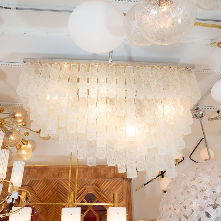 Monumental rectilinear flush mount ceiling fixture composed of cascading, staggered
