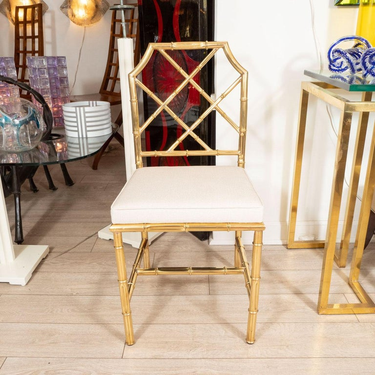 Set of six newly upholstered, brass faux bamboo chairs.