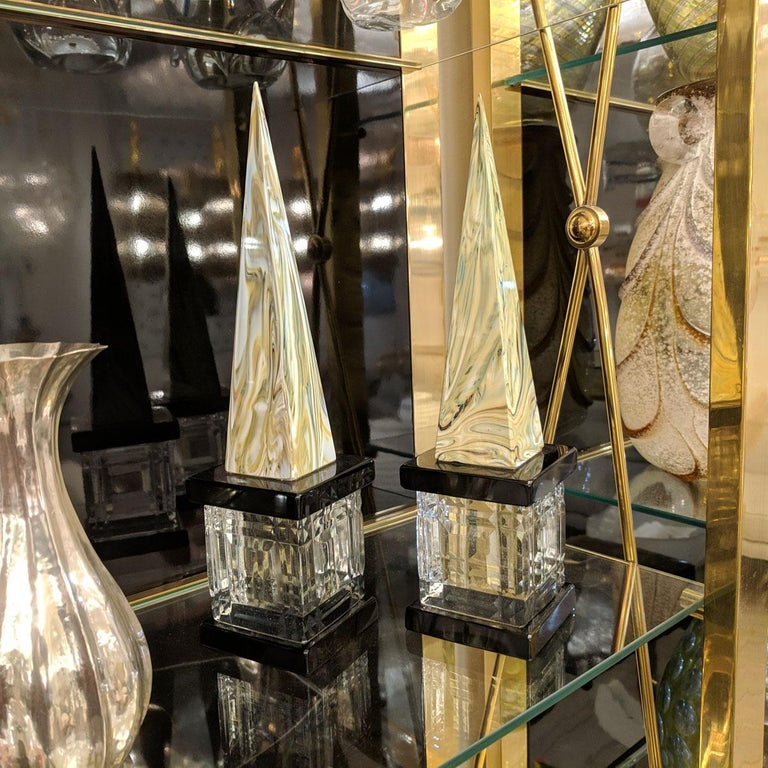 Pair of marbleized Murano glass obelisks with clear faceted glass bases.