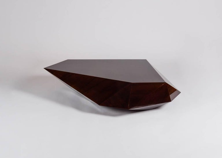 """Pietra, which means """"rock"""" in Italian, is a table of stained lauro, has the appearance of a naturally occurring angular geological formation. By Rome based architect Achille Salvagni, recognized worldwide for bringing together Italian craftsmanship"""