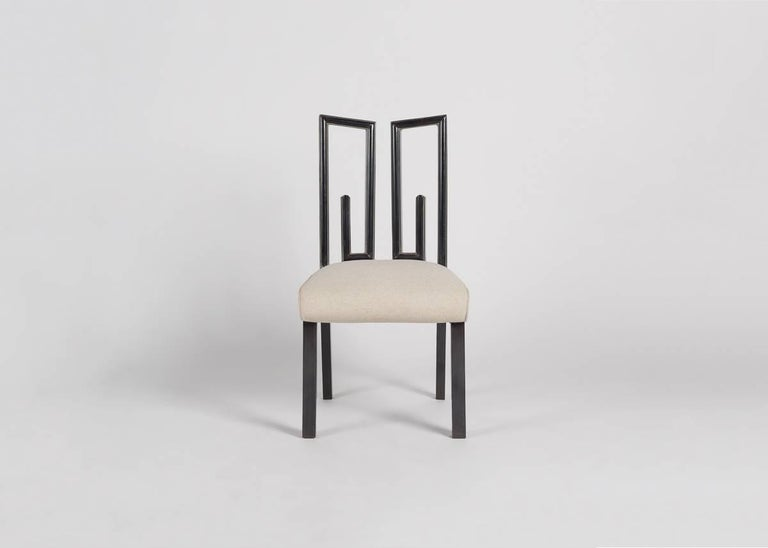 A dynamic, midcentury side chair with a remarkable geometric back, from James Mont, the the notable American designer.