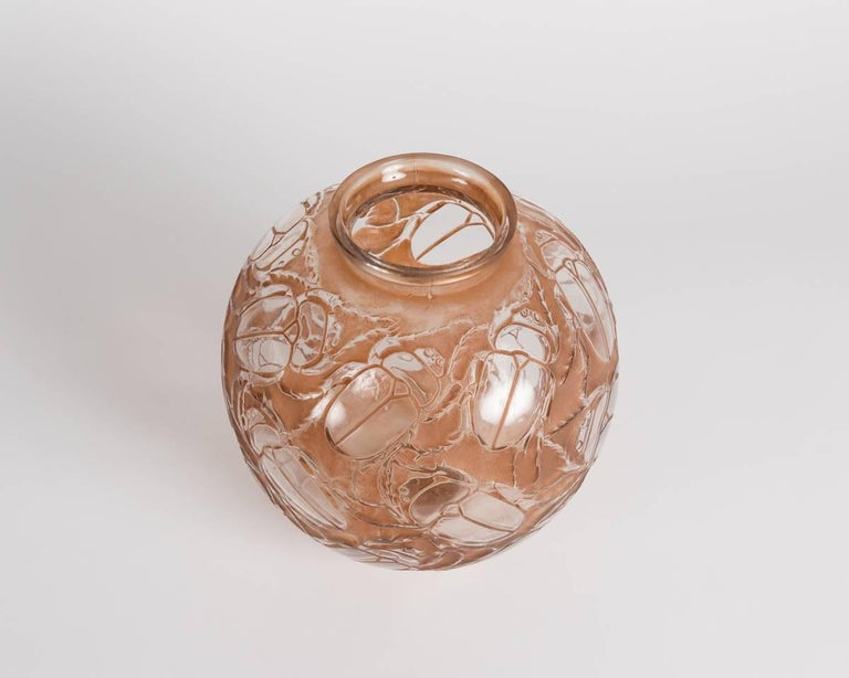 Molded glass vase with original sepia patina by French designer René Lalique.