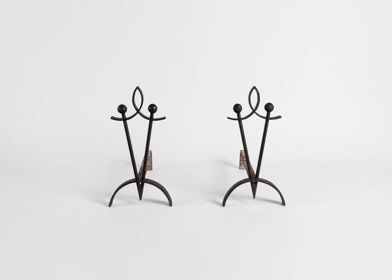 Pair of tapered andirons from France.