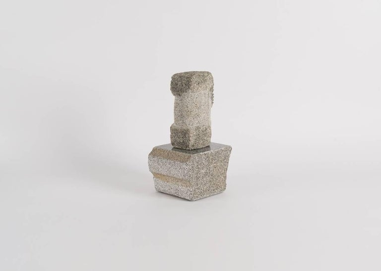 Two pieces of granite, a sculpture by Korean-American artist Yongjin Han.