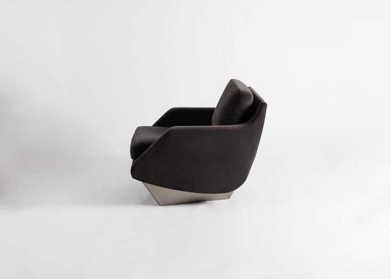A companion to his well known sofa, this fabulous armchair by architects Georgis & Mirgorodsky features a plush seat and two supports of lacquered maple.   May be made to order in COM fabric, with supports in a range of finish options.
