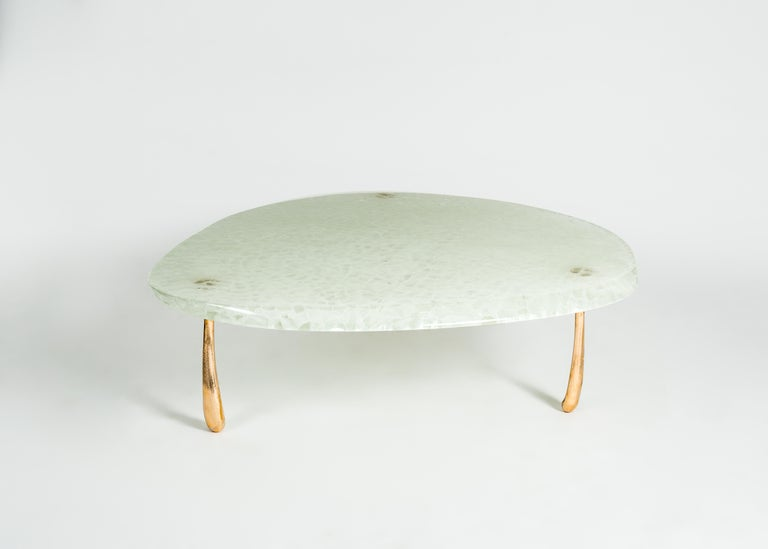 Mura low table is created in collaboration with Toronto-based glass design and fabrication atelier Jeff Goodman Studio (JGS). It pairs STACKLAB's signature solid-bronze Jupiter leg castings with a droplet-shaped top of kiln-fused Temple glass. The