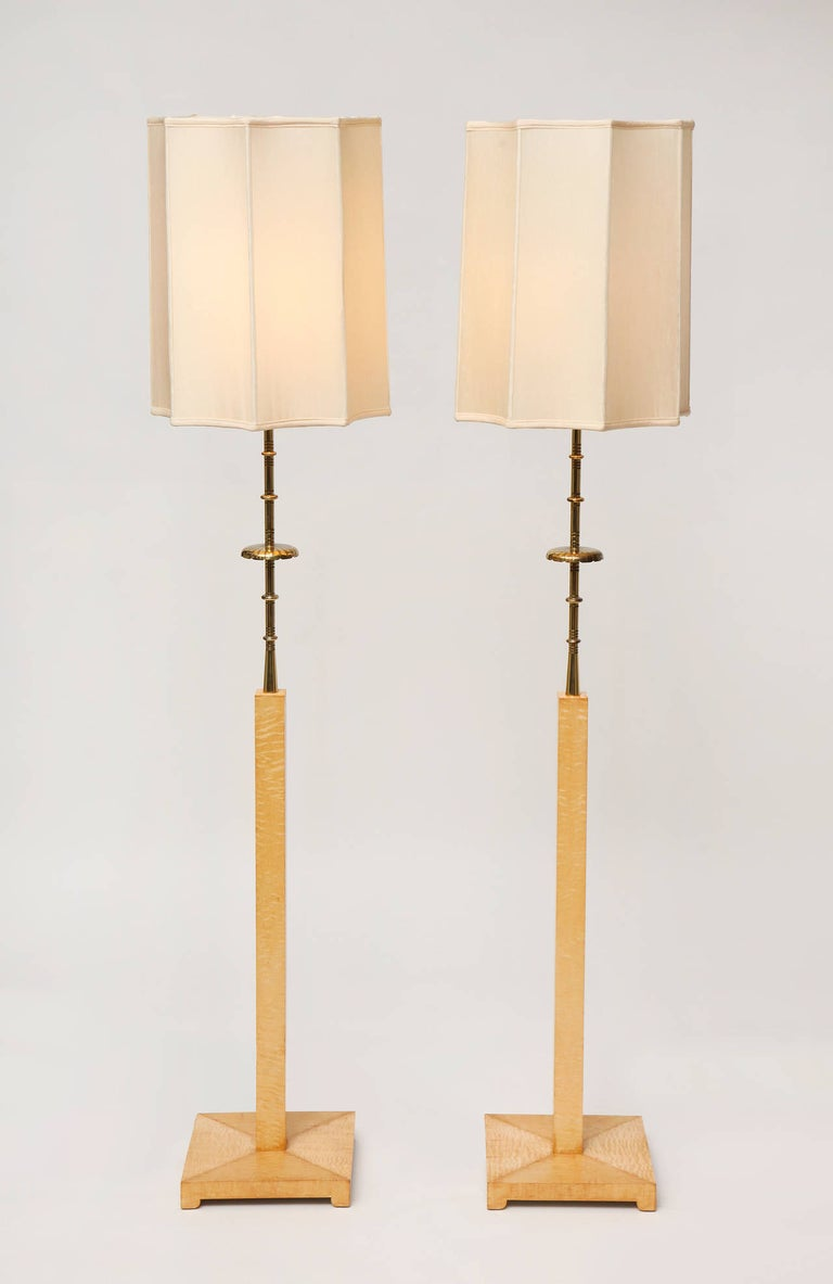 Curly maple and brass floor lamp by Tommi Parzinger, with original silk shade.  This floor lamp was custom designed for the Appleman Commission.  This perfectly proportioned floor lamp in curly maple, brass, and silk, from the famous mid-century