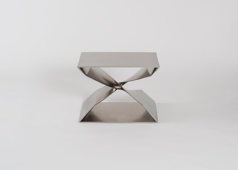 Sculptural brushed stainless steel stool by Carol Egan.  This sculptural stool is part of a line of contemporary furniture designed by blending digital technology with fine traditional craftsmanship. Cast in stainless steel, the stool features two