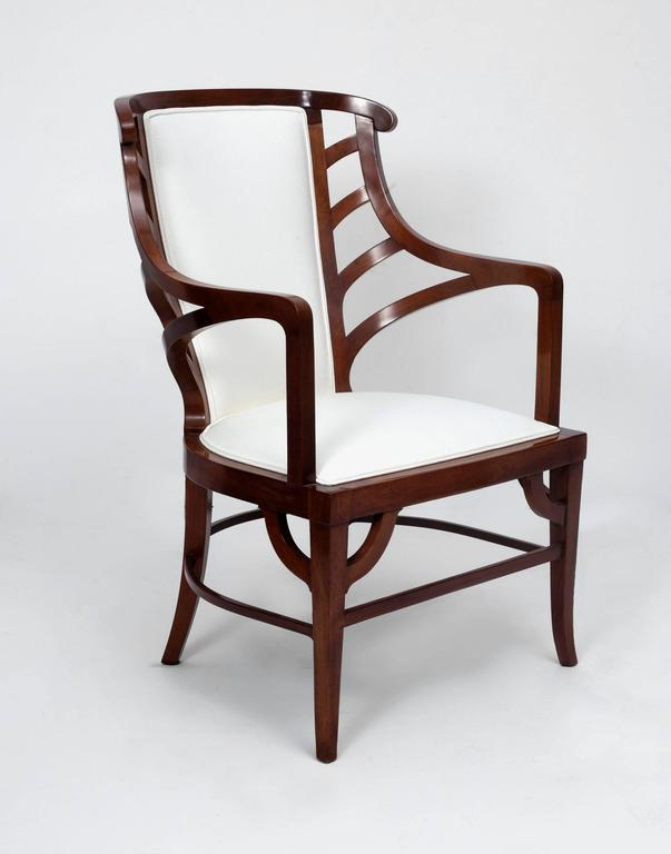 Art Nouveau armchair in walnut and white leather, in the manner of Henri van de Velde.