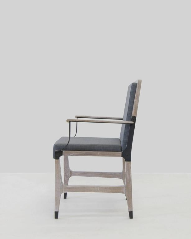 Dining armchair by Mark Zeff in bronze, limed oak, and Belgian linen.