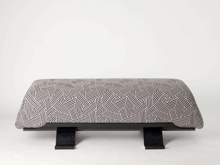 Bench by Achille Salvagni, black lacquer base with patinated and polished bronze legs. 