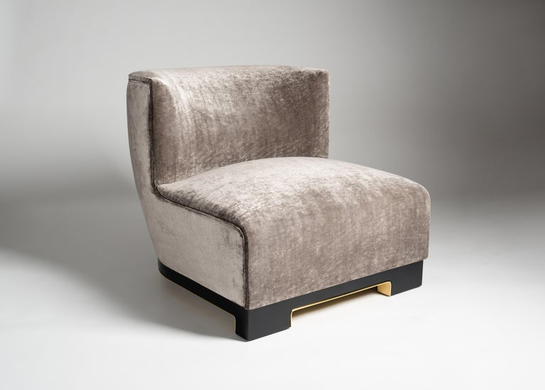 Edition of 40.  Vittoria is a plush, armless club chair by Italian designer Achille Salvagni. Its lacquer base is available in a variety of colors, and accented with a rim of polished bronze. Upholstery is customizable.