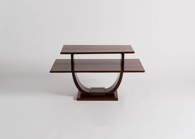 Fine early Art Deco two-tiered flamed mahogany side table by Jules Leleu (1883-1961)  Illustrated in Mobilier et Décoration 1931, p. 490 and p. 491 (Interiors of the Comtesse de Marchena's residence).