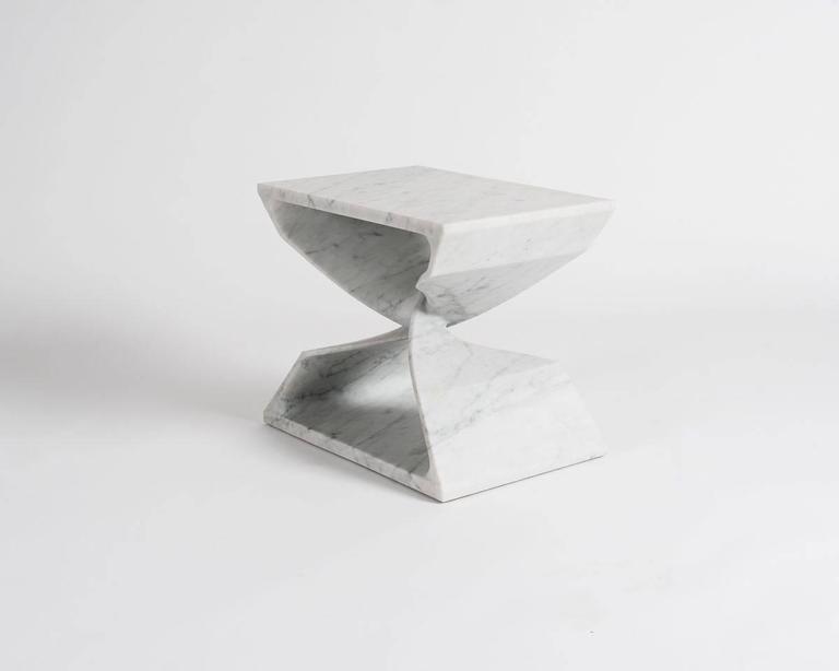 Sculptural marble stool by Carol Egan.