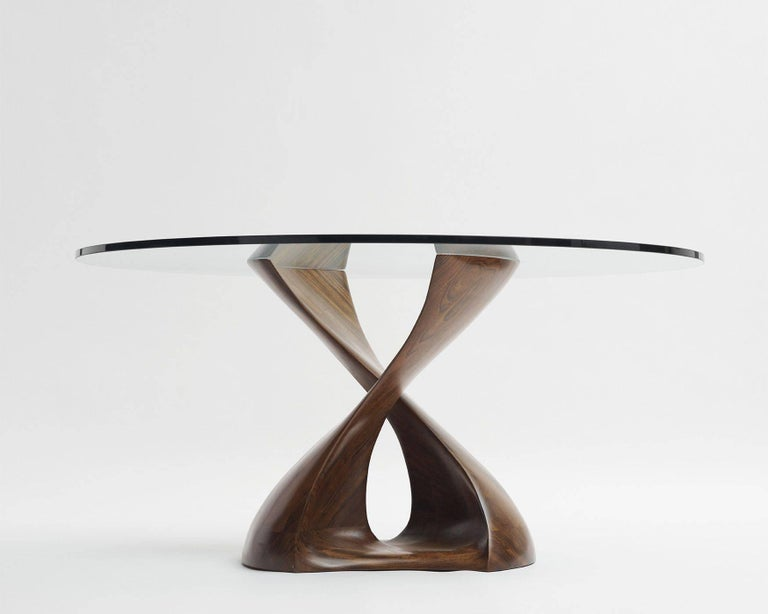 Sculptural carved African Mozambique base and glass top.