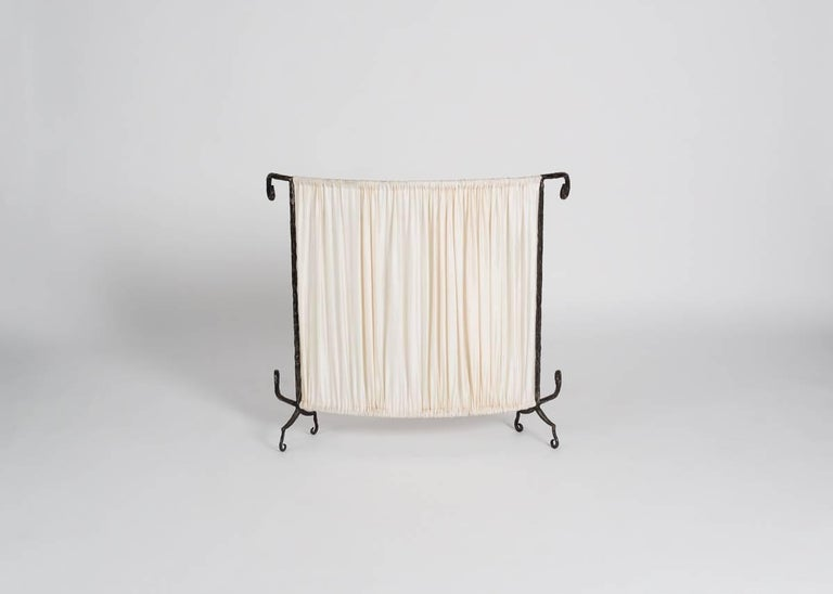 A set of three elegant radiator covers with curlicue wrought iron frames, and original beige fabric, from the famed design duo for the 1980s and 1990s.