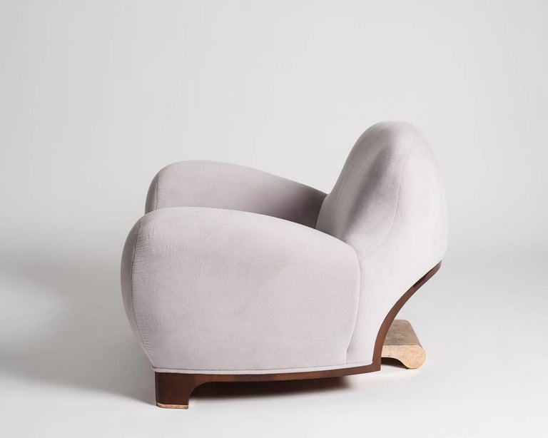 Limited edition of 20 + AP.  Tato is a club chair with a polished walnut base and an underlying bronze frame, a part of which features prominently from behind.