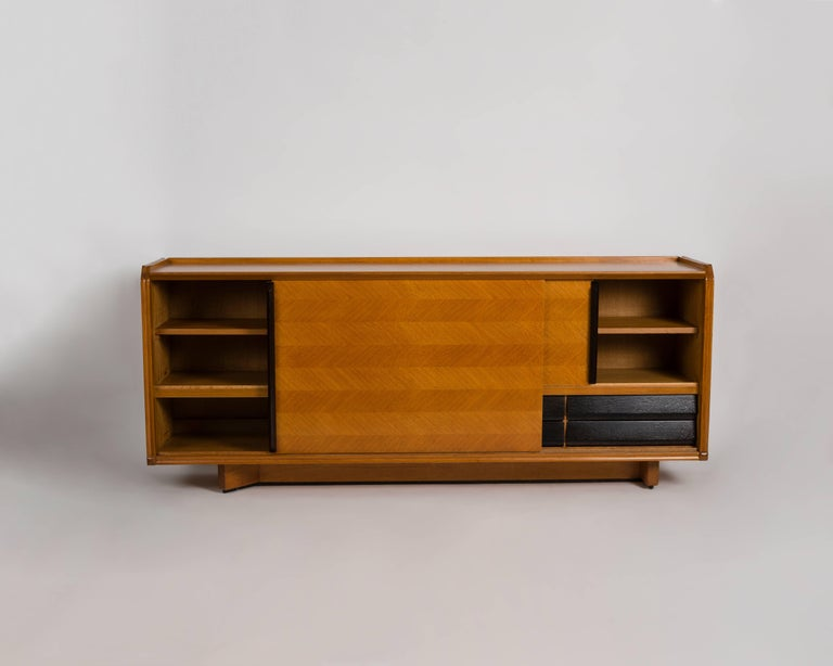 This Midcentury Buffet In A Light Veneered Oak Has Sliding Doors And Drawers