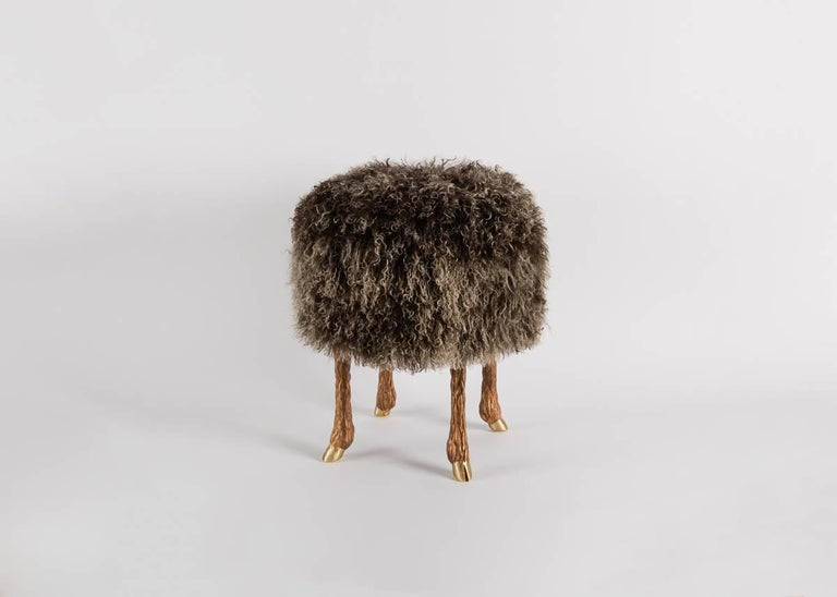 This surrealistic stool, which rests on silver or bronze legs modeled after a goat's, and is upholstered in lamb's wool, is a successful new take on a centuries-old tradition: transforming the pastoral into exceptional, lush decor.