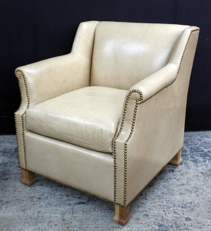 Pair of custom leather club chairs in a butter soft