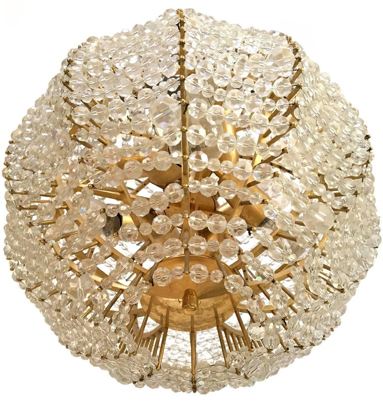 An original gilt brass supernova chandelier with hand-cut glass beads.  Made in the 1960s by Vienna based company Bakalowits & Sohne.