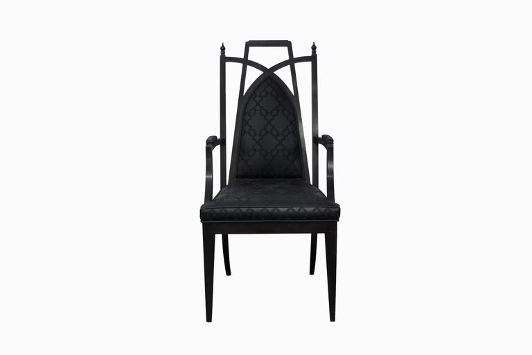 Pair of chinoiserie armchairs, ebonized with stylized fabric, in the style of James Mont, American, 1950s.
