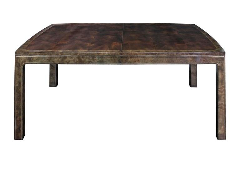 Dining table with two leaves in bookmatched Carpathian elm with brass inlays by Mastercraft, American, 1960s.