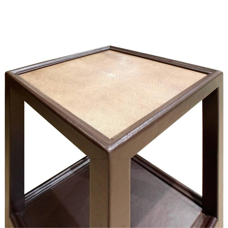 Telephone table shown here in hand-stitched leather with inset shagreen top on polished brass castors designed by Mary Forssberg for Lobel Modern. This table is exceptionally crafted. It can be made in any size and color and in a variety of