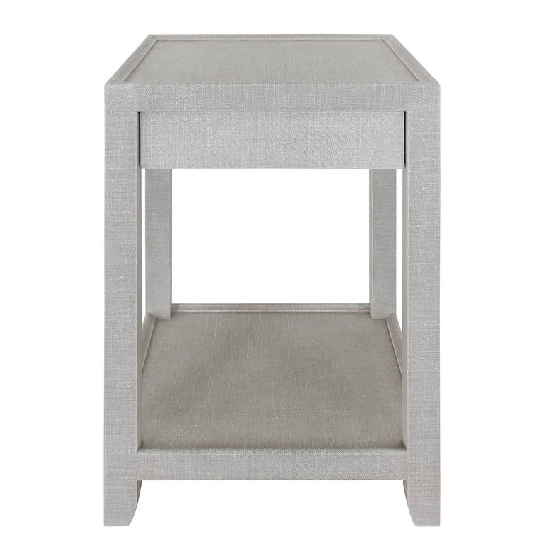 Pair of telephone style nightstands with one drawer under apron and lower shelf covered in two-tone lacquered linen. Drawer lined with moire fabric.