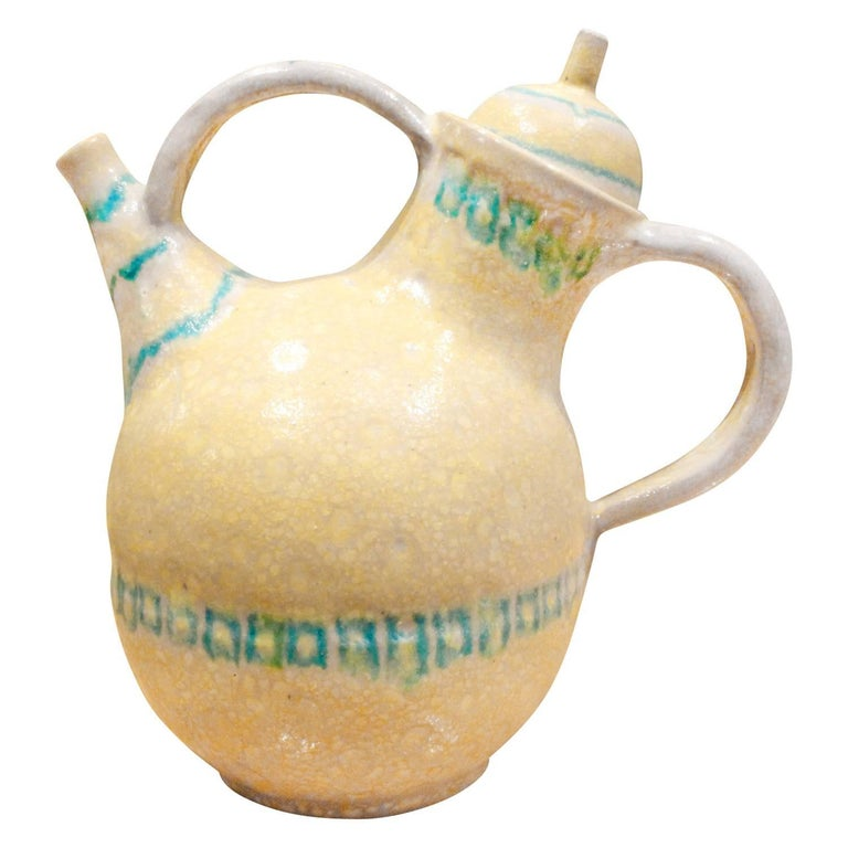 33 Piece hand-thrown ceramic coffee and espresso service set with iconic yellow and blue colors and salt glaze by Guido Gambone, Italy, 1950s (signed on the bottom on all pieces with donkey). This is a rare large set by Guido Gambone. Dimensions