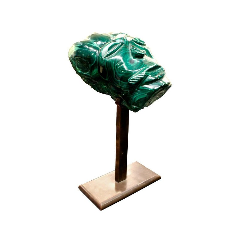 Hand-carved and polished malachite head on custom bronze base with felt underside by Karl Springer, American, 1970s.