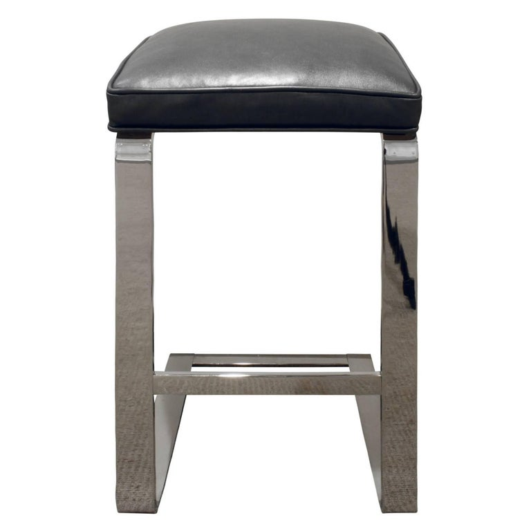 Pair of bar stools in polished chrome with cantilevered seats upholstered in new metallic gray leather by Milo Baughman, American, 1970s.