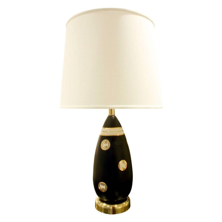Studio made porcelain table lamp with hand-painted gold medallions with brass base attributed to Zaccagnini (Italy) for Marbro Lamp Company, American, 1960s. Original