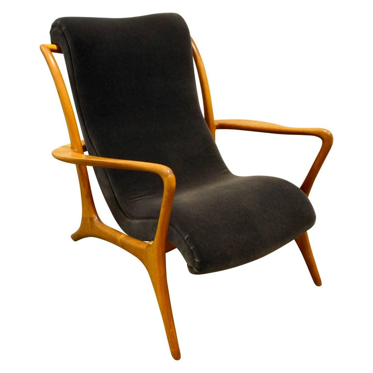 Sculpted walnut Contour chair newly upholstered in dark blue velvet by Vladimir Kagan, American, 1950s. This is an iconic Kagan design with meticulous craftsmanship.